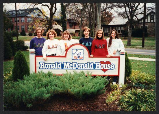 Six Epsilon Psi Chapter Members by Ronald McDonald House Sign Photograph, November 1994