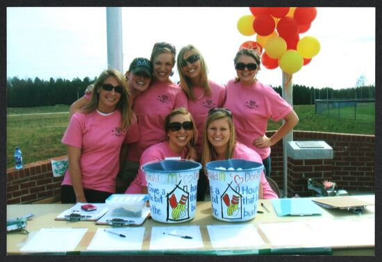 Eta Xi Chapter Members With Collection Buckets at Golf Tournament Photograph