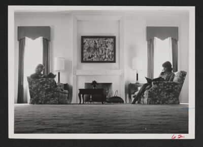 Two Phi Chapter Members Studying in Living Room Photograph