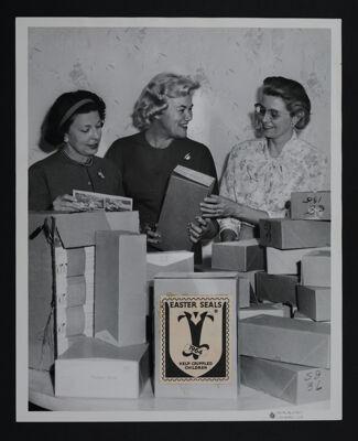 Three Gamma Mu Gamma Chapter Members Packing Easter Seals Photograph, c. 1964