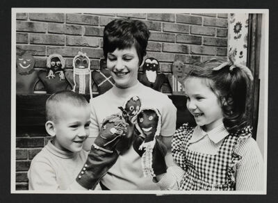 Alumnae and Children Playing With Puppets Photograph, 1973