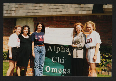 Epsilon Lambda Chapter Members Presenting Check to Arlington Women's Shelter Photograph, March 28, 1998
