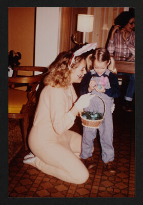 Delta Nu Chapter Member and Child at Easter Seal Service Project Photograph, c. 1981
