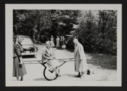 National Council Members Playing with Cart at Council Meeting Photograph, June 1950