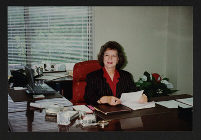 Nancy Leonard at Desk Photograph
