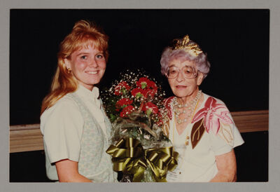 Ruth Winsor Receiving Carnations from Phi Chapter President Photograph, c. 1990