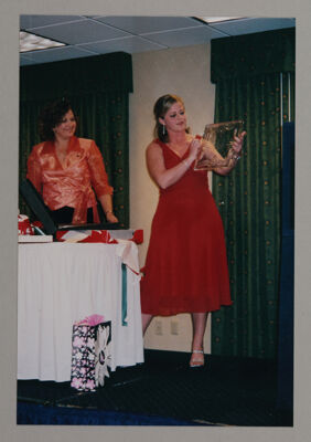 Marsha Grady and Deb Stephens Opening Gifts at Iota Omega Chapter Installation Photograph, April 23, 2005