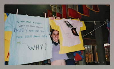 Alpha Chi Omega Member Hanging Domestic Violence Awareness Shirts Photograph, April 19, 2002