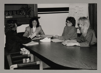 Second Century Campaign Committee Members Finalizing Shoe Marketing Campaign Photograph, c. 1985