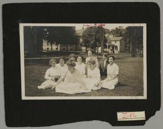 Nine Zeta Chapter Members Sitting in Grass Photograph